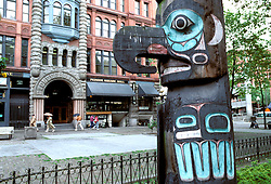 Washington, Seattle: Pioneer Square, totem pole.  Photo #waseat102..Photo copyright Lee Foster, www.fostertravel.com, 510/549-2202, lee@fostertravel.com