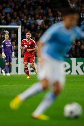 Bayern Midfielder Franck Ribery (FRA) looks on as Man City Midfielder Jesus Navas (ESP) breaks during the first half of the match - Photo mandatory by-line: Rogan Thomson/JMP - Tel: Mobile: 07966 386802 - 02/10/2013 - SPORT - FOOTBALL - Etihad Stadium, Manchester - Manchester City v Bayern Munich - UEFA Champions League Group D.