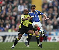 Photo: Lee Earle.<br /> Portsmouth v Manchester City. The Barclays Premiership. 11/03/2006. City's Trevor Sinclair (L) battles with Gary O'Neil.