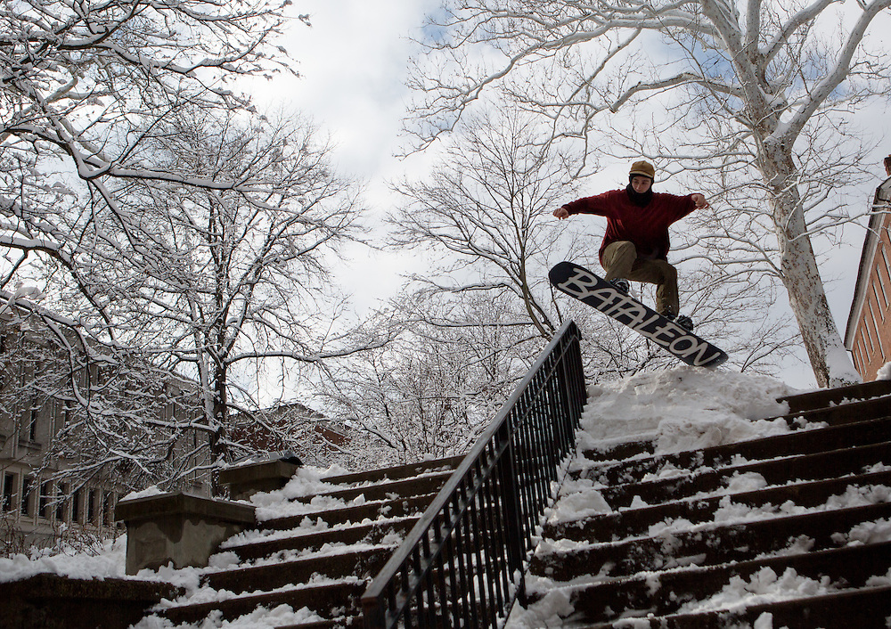 Ohio University senior Mark Clavin catches air on his snowboard near Alden Library on Feb. 3, 2014, when classes were canceled due to inclement weather. Photo by Lauren Pond