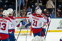 KELOWNA, BC - NOVEMBER 26: Jake Neighbours #21  and Sebastian Cossa #33 of the Edmonton Oil Kings celebrate the shoot out win against the Kelowna Rockets with a final score 1-0 at Prospera Place on November 26, 2019 in Kelowna, Canada. (Photo by Marissa Baecker/Shoot the Breeze)
