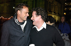 Left to right, JAMIE THEAKSTON and PIERS MORGAN at the opening of the Natural History Museum's ice rink, Cromwell Road, London on 14th November 2006.<br />