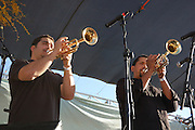 Calexico horn section plays during the headliner concert at Tucson's first-ever Fiesta en el Barrio Viejo in 2010.