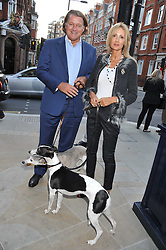 ADRIAN & SARAH COOPER with their dogs Madison & Brook at the 10th anniversary of George in association with The Dog's Trust held at George, 87-88 Mount Street, Mayfair, London on 13th September 2011.
