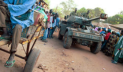 A Senegalese army tank drives through the border of Guinea Bissau  and Senegal  in the Casamance region of West Africa. Rebels in Senegal's southern Casamance [Cassamance] province have been waging a bloody independence campaign against the central government in Dakar since 1982. The Movement of Democratic Forces in the Casamance (MFDC) has long used Senegal's southern neighbor Guinea-Bissau as a launching pad for attacks inside Cassamance. Guinea-Bissau's former president, Joao Bernardo Viera, was accused of supplying the rebels with weapons until he was overthrown in a coup in May 1999.    (Photo by Ami Vitale)