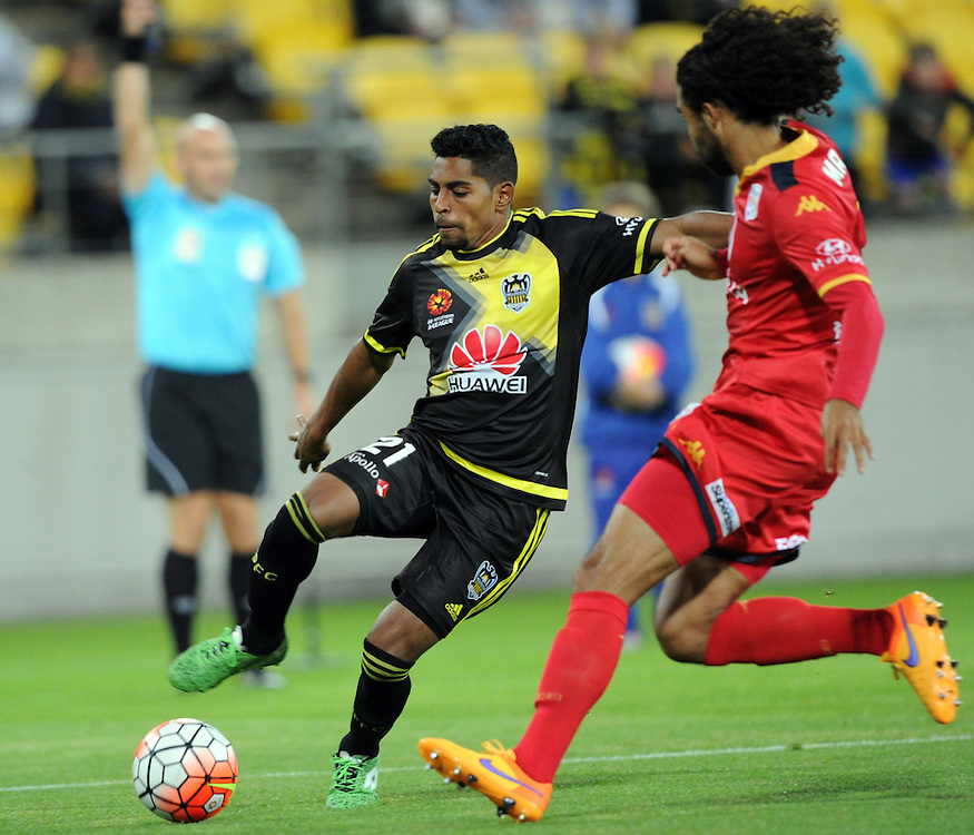 Phoenix's Roy Krishna, left, plays across Adelaide United's Osama Malik in the A-League football match at Westpac Stadium, Wellington, New Zealand, Friday, November 13, 2015. Credit:SNPA / Ross Setford
