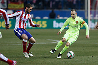 Atletico de Madrid´s Mario Suarez and Barcelona´s Andres Iniesta during Copa del Rey `Spanish King Cup´ soccer match at Vicente Calderon stadium in Madrid, Spain. January 28, 2015. (ALTERPHOTOS/Victor Blanco)