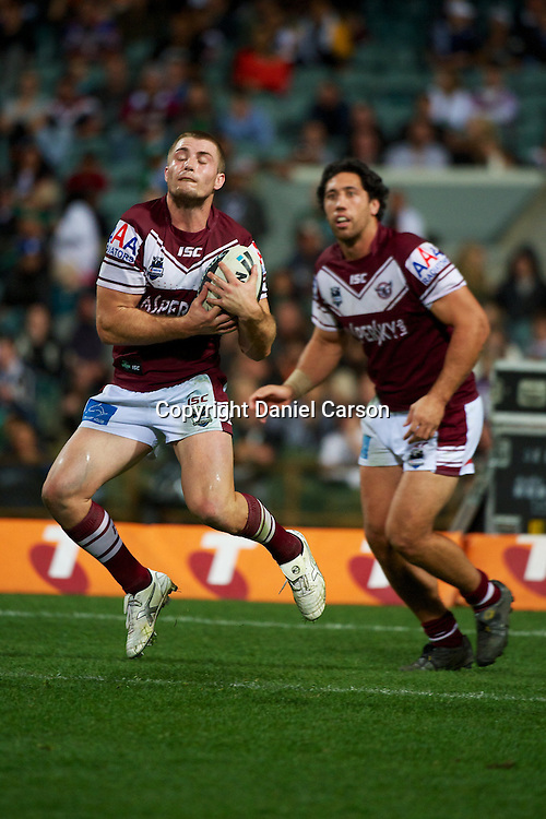 Kieran Foran of the Sea Eagles catches a kick during the NRL Rugby League match, Vodafone Warriors v Manly Sea Eagles at Patersons Stadium, Perth, Australia on Saturday 28 July 2012. Photo: Daniel Carson/photosport.co.nz