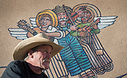 em122116g/jnorth/Glen Strock takes a break from working on a mural to talk with people who have came to see it. This is on the side of a Santa Fe County building off West Alameda in Santa Fe, Wednesday December 21, 2016. (Eddie Moore/Albuquerque Journal)