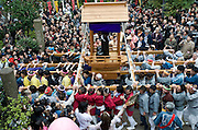 "Participants carry a portable shrine on which is mounted a black phallus made from stone in the grounds of Wakamya Hachimangu shrine during the Kanamara Festival in Kawasaki, Japan on 04 April 2010. The fertility festival, often just called the ""penis festival,"" has been held since the early 1600s and also aims to promote awareness of AIDS and STDs.."