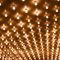 Photo of theater marquee lights with rows of lightbulbs on a theatre entrance. Also commonly known as casino and broadway lights.