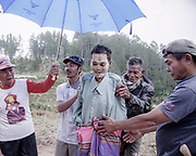 Family members replace Lamba's clothing. <br /> He died 10 years ago at age 80.<br /> <br /> Ma'nene is a tradition that takes place in August after harvest where the bodies of the dead loved ones are exhumed to be cleaned, groomed and dressed. For most, it's a bittersweet moment, a chance to reunite and physically see and touch and reconnect with loved ones who had passed on.