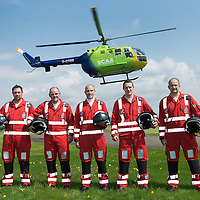 SCAA..Scotland's Charity Air Ambulance paramedics pictured with Helimed 76 at the base in Perth, pictured from left, Alex Holden, Bruce Rumgay, John Pritchard, Wayne Auton and Andy Walker.<br /> The helicopter is a Bolkow 105 supplied by Bond Aviation Services.<br /> Picture by Graeme Hart.<br /> Copyright Perthshire Picture Agency<br /> Tel: 01738 623350  Mobile: 07990 594431