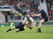 Twickenham, United Kingdom. George CULLEN get a low tacle in on Jamie ROBERTS, during the 2015 Men's Varsity Match, Oxford vs Cambridge, RFU Twickenham Stadium, England.<br /> <br /> Thursday  10/12/2015<br /> <br /> [Mandatory Credit. Peter SPURRIER/Intersport Images].