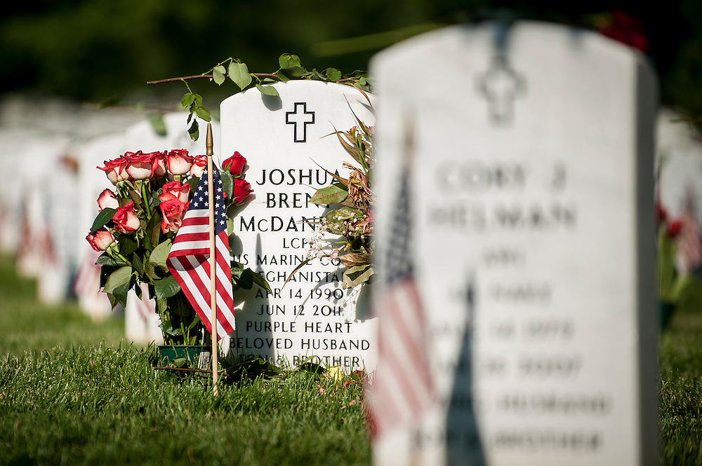A headstone is adorned with roses on Memorial Day at Arlington National Cemetery in Arlington, Virginia, USA, on 26 May 2014.