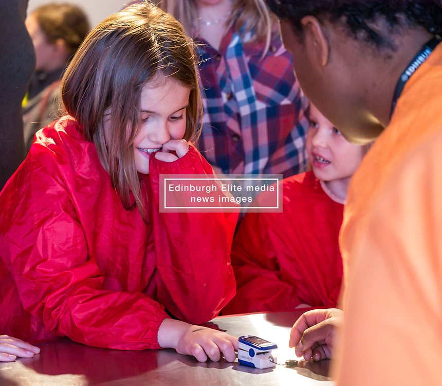 City Arts Centre, Edinburgh, Scotland, United Kingdom, 9 April 2019. Edinburgh Science Festival:  Liucy, age 8 years, and other children have fun learning about blood at the Blood Bar drop in event with Science Communicator Jairus at the Science Festival. <br /> <br /> Sally Anderson | EdinburghElitemedia.co.uk