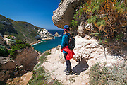 Hiker above Potato Harbor, Santa Cruz Island, Channel Islands National Park, California USA