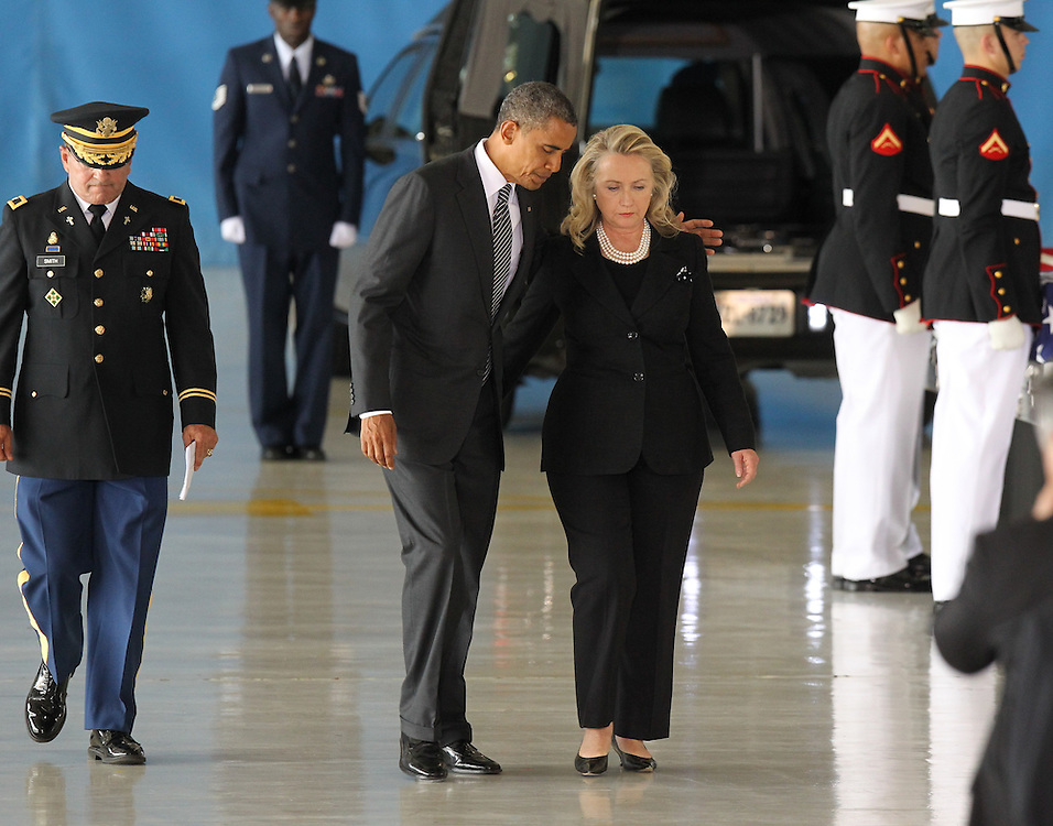 President Barack Obama  and Secretary of State Hillary Clinton take part in the Transfer of Remains Ceremony marking the return to the United States of the remains of the four Americans killed this week in Benghazi, Libya, at Joint Base Andrews near Washington, DC on September 14, 2012.