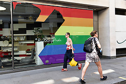 © Licensed to London News Pictures. 29/06/2018. LONDON, UK.  A business in Soho joins other stores in the Oxford Street area with a rainbow makeover in support of the Pride Festival, a worldwide celebration of the LGBT community.  The popular annual Pride London parade takes place in the capital on 7 July.  Photo credit: Stephen Chung/LNP