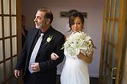 Melissa and Jordan Bencomo celebrate their wedding with family and friends at Arch of Reno Chapel in Reno, Nevada, on April 5, 2014. (Stan Olszewski/SOSKIphoto)