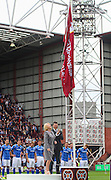 Hearts CEO unveils the championship flag at the Ladbrokes Scottish Premiership match between Heart of Midlothian and St Johnstone at Tynecastle Stadium, Gorgie, Scotland on 2 August 2015. Photo by Craig McAllister.