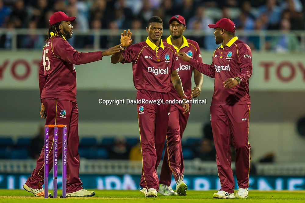 London,UK. 27 September 2017. Alzarri Joseph is congratulated by team mates after taking the wicket of Joe Root. England v West Indies. In the fourth Royal London One Day International at the Kia Oval.