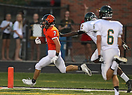 Prairie's Mitchell Dellamuth (7) runs into the end zone for a touchdown after a reception during their game at John Wall Memorial Stadium at Prairie High School in Cedar Rapids on Friday, September 6, 2013.