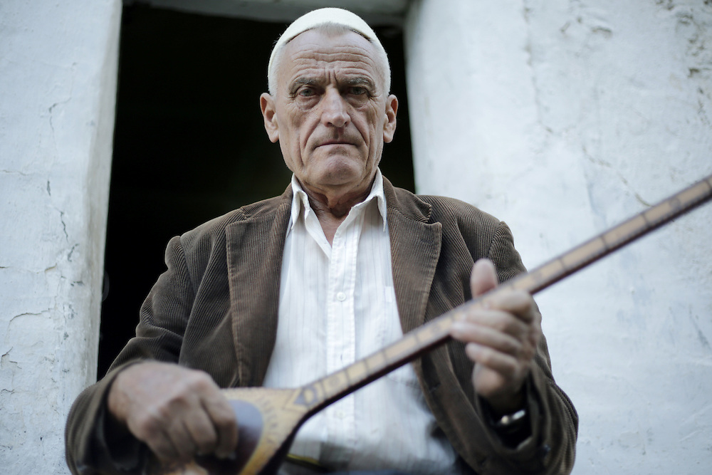 Martin Pisha, 82 years old, inhabitant of Theth, playing the traditional lahuta instrument.  Albania