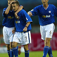 Clyde v St Johnstone....12.08.03..Bell's Cup 2nd round<br />Keigan Parker is congratulated by Simon Donnelly and Ian Maxwell<br /><br />Picture by Graeme Hart.<br />Copyright Perthshire Picture Agency<br />Tel: 01738 623350  Mobile: 07990 594431
