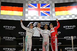 Rennen des Grand Prix von Abu Dhabi auf dem Yas Marina Circuit / 271116<br /> <br /> ***Abu Dhabi Formula One Grand Prix on November 27th, 2016 in Abu Dhabi, United Arab Emirates - Racing Day *** <br /> <br /> Nico Rosberg (GER) Mercedes AMG F1, Lewis Hamilton (GBR) Mercedes AMG F1 and Sebastian Vettel (GER) Scuderia Ferrari <br /> 27.11.2016. Formula 1 World Championship, Rd 21, Abu Dhabi Grand Prix, Yas Marina Circuit, Abu Dhabi, Race Day.<br /> - www.xpbimages.com, EMail: requests@xpbimages.com - copy of publication required for printed pictures. Every used picture is fee-liable. © Copyright: Charniaux / XPB Images