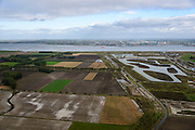 Nederland, Zeeland, Zeeuws-Vlaanderen, 23-10-2013; Van rechts naar links onder in beeld: Belgische Prosperpolder en reeds onder water gezet, daarnaast De Hedwige Polder en tenslotte een klein stukje van Het Verdronken Land van Saeftinge. Aan de horizon de Belgische kant van de Westerschelde naar de Haven van Antwerpen. <br /> Borderland Belgium and the Netherlands, the Drowned Land Saeftinge (l) and the Belgian polder (right), under water due to environmental compensation. Westerschelde end entrance of the port of Antwerp on the horizon.<br /> luchtfoto (toeslag op standaard tarieven);<br /> aerial photo (additional fee required);<br /> copyright foto/photo Siebe Swart.