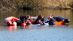 © under license to London News Pictures. 22/03/2011.  Divers recover a body, thought to be Alfie Skelton from Heathfield Pond in Cobham, Surrey. Alfie fell into the water from a dinghy at 4:45pm yesterday. Luke Wigmore was rescued and remains in Epsom Hospital. Photo credit should read Cliff Hide/LNP..
