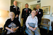 World War I Veteran Harry Landis, 107, at home in Sun City Center.  Landis is one of only four known surviving veterans of WWI.  Also pictured is his 99-year-old wife, Eleanor, and three retired officers from the Military Officers Association of America, Lt. Col. Paul Wheat, Maj. Jerry Foppe and Cmdr. Ed Socha.