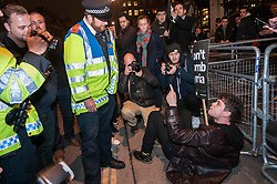 "© Licensed to London News Pictures. 02/12/2015. London, UK. Police requests a protestor to move out of the road to allow traffic to pass.  As MP's decide in Parliament whether to vote for the UK to commence air strikes in Syria, thousands of anti-war protestors stage a ""die in"" in Parliament Square urging MPs to vote against military action.  Photo credit : Stephen Chung/LNP"