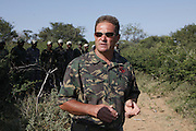 Nkwe wildlife security services offer a paramilitary - style rhino protection service that operates in the several private game reserves in the Limpopo area of South Africa..Nkwe's recruits undergo a basic two week training program focusing on military discipline and endurance to become a field ranger. From this stage the field rangers may be selected for an advance course that focuses on firearms and tactical training. Once this is completed they will be given rank and go on armed patrol to protect the rhinos...Pic shows: Nkwe director Simon Rood and his new recruits...Nkwe Wildlife Security Services based in the Lapalala Wilderness Area, Limpopo, South Africa...© Zute Lightfoot