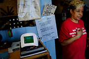 Cheryl Hurt walks past the air quality monitor that she keeps in her day-care center that she runs out of her home in Clairton, Pa. Along with John Marcus, from nearby Jefferson Hills, Hurt has sued U.S. Steel over emissions from the quenching towers of its Clairton Works coke plant. The lawsuit, claims that the U.S. Steel plant has not reduced its toxic emissions and as a result, children need to use inhalers while playing sports because of asthma.<br />