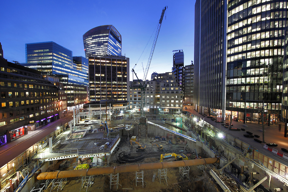 Installation of large diameter temporary tubes that support the secant walls whilst the exaction process continues beneath. JFH have 42,000m3 of material to remove.  JFH Demolition site at 10 Fenchurch Avenue in the City of London. John F Hunt Demolition. March 2016