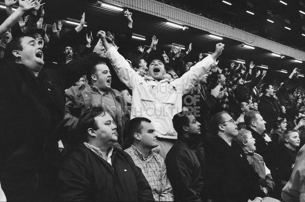 Chelsea fans cheering on the stands