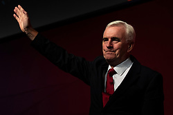 © Licensed to London News Pictures. 24/09/2018. Liverpool, UK. Shadow Chancellor John McDonnell MP waves to the audience after he delivered his speech at the Labour Party Conference 2018. Photo credit: Rob Pinney/LNP