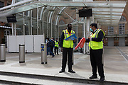 "Employees of Network Rail direct commuting passengers from this now exit-only entrance to Liverpool Street Station in the City of London, to an alternative around the corner during the UK Coronavirus pandemic. The UK government has today lowered the national Covid-19 alert level from 4 to 3, meaning the virus is considered to be ""in general circulation .. with ""a gradual reduction in restrictions"". The number of deaths from Coronavirus in the last 24hrs however, has increased by 287 to 37,979,  on 19th June 2020, in the City of London, England. All passengers on the public transport system are still being asked to wear face covering."