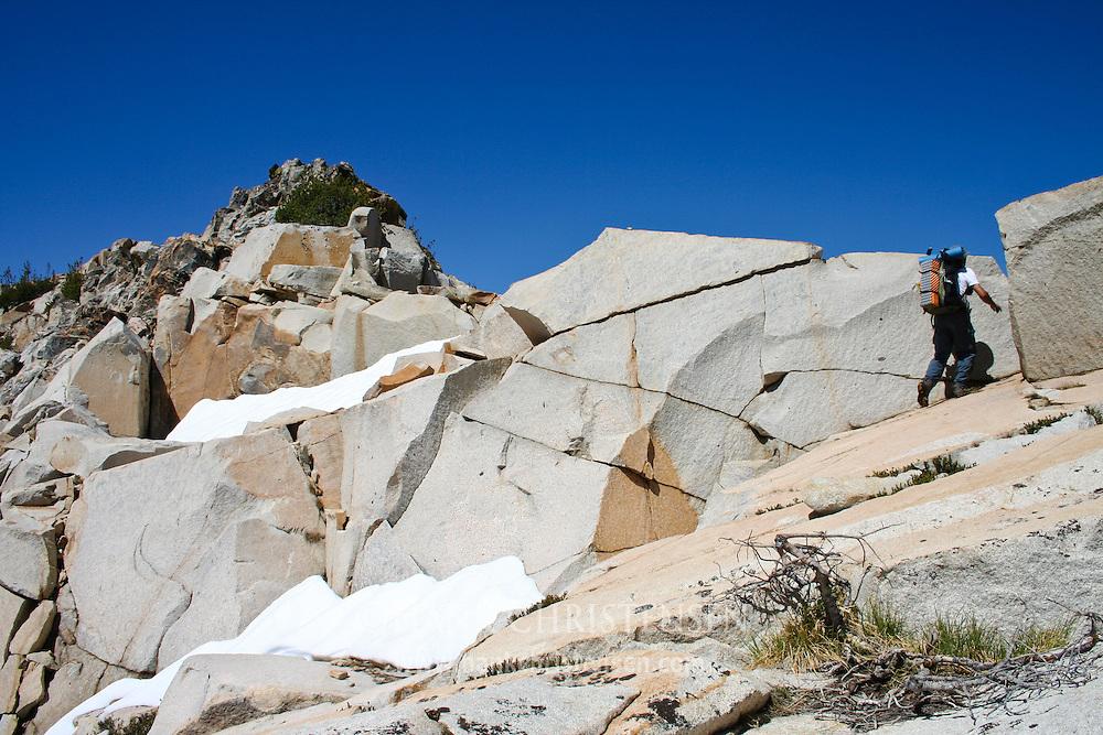 Backpacker ascending Kendrick Peak, Yosemite National Park