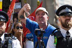 An activist from anti-racism group Stand Up To Racism hurls abuse at supporters of right wing activist Tommy Robinson as he wins his release on bail ahead of a new hearing to be held at The Old Bailey, following his imprisonment on contempt of court charges. London, August 01 2018.