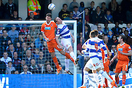 Blackpool's Apostolos Vellios competing in the air against Queens Park Rangers Richard Dunne. Skybet football league championship match , Queens Park Rangers v Blackpool at Loftus Road in London  on Saturday 29th March 2014.<br /> pic by John Fletcher, Andrew Orchard sports photography.