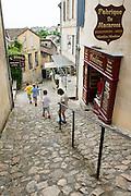 """FRANCE, Saint Emilion<br /> A """"tertre"""" (steep alley) in Saint Emilion and a pastry shop selling Saint Emilion's famous """"macarons"""""""