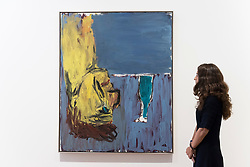 """© Licensed to London News Pictures. 02/10/2018. LONDON, UK. A staff member views """"Trinker + Flasche (Drinker + Bottle)"""", 1981, by Georg Baselitz.  Preview of """"A Focus on the 1980s"""", an exhibition of works by Georg Baselitz at Galerie Thaddaeus Ropac in Mayfair.  The show features seminal paintings, previously unseen works, drawings and early sculptures by the artist during his breakthrough decade and runs 3 October to 21 November 2018.  Photo credit: Stephen Chung/LNP"""