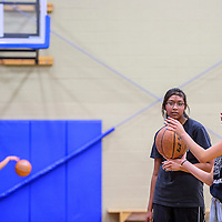 110414       Cable Hoover<br /> <br /> Raylina Aragon gets some tips from senior Tanya Watchman during the Rehoboth girls basketball practice at Rehoboth High School Tuesday. Basketball season kicks off later this month and the Rehoboth girls will face Zuni for their first home game Nov. 20.