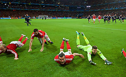 LILLE, FRANCE - Friday, July 1, 2016: Wales' Gareth Bale and goalkeeper Wayne Hennessey slide on the pitch as he celebrates after a 3-1 victory over Belgium and reaching the Semi-Final during the UEFA Euro 2016 Championship Quarter-Final match at the Stade Pierre Mauroy. (Pic by David Rawcliffe/Propaganda)