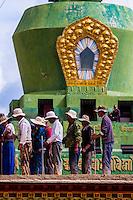 Workers tamp down wet cement atop a building at Samye Monastery, Chatang, Lhoka (Shannan) Prefecture, Tibet (Xizang), China