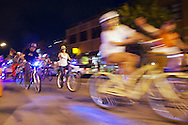 "The seasonal weekly Thursday night Cruiser Ride, usually filled with unusual bikes, colorful lights and often costumed riders, snakes through downtown and outlying neighborhoods as participants cheerfully wish onlookers ""Happy Thursday"" in Boulder, CO. © Brett Wilhelm"