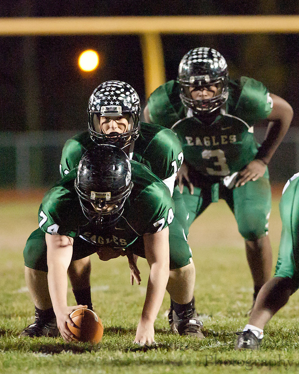 West Deptford High School center Ryan Flaherty (24), quarterback Jake Hannan (13), and Gerald Towns (3)line up for the snap during a Group 2 first round playoff game at West Deptford High School on Friday November 11, 2011. (photo / Mat Boyle)